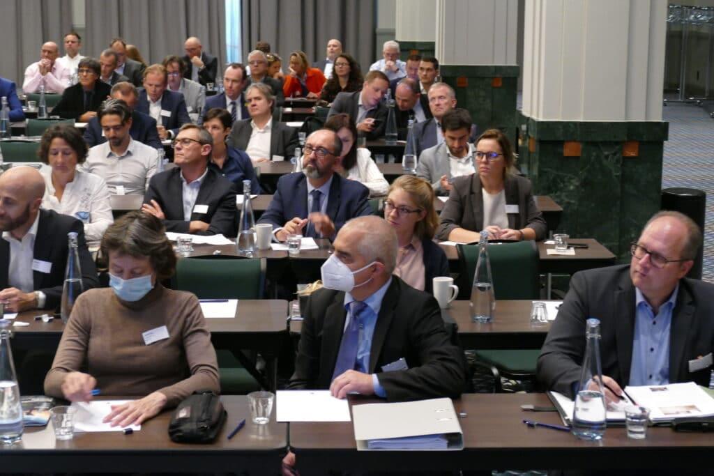 Delegates listening*
